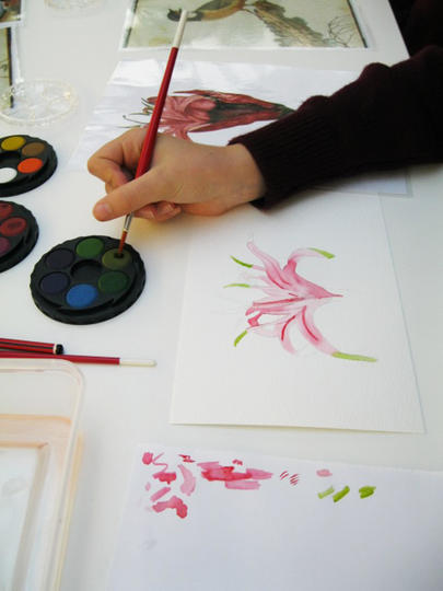 A child painting a picture of a flower