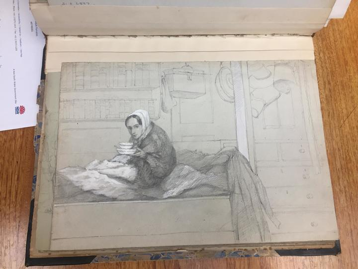 A drawing of a young woman sitting on a bunk bed in a cabin on a ship