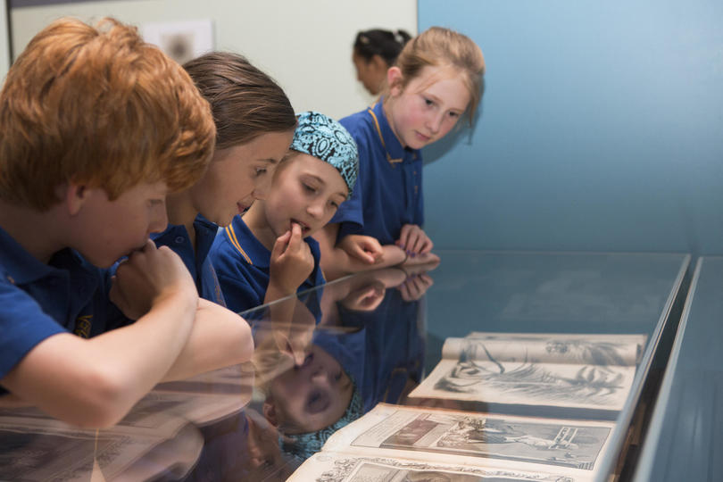 Children looking at objects in a gallery