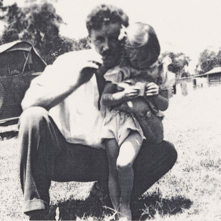 Man and child in rural landscape
