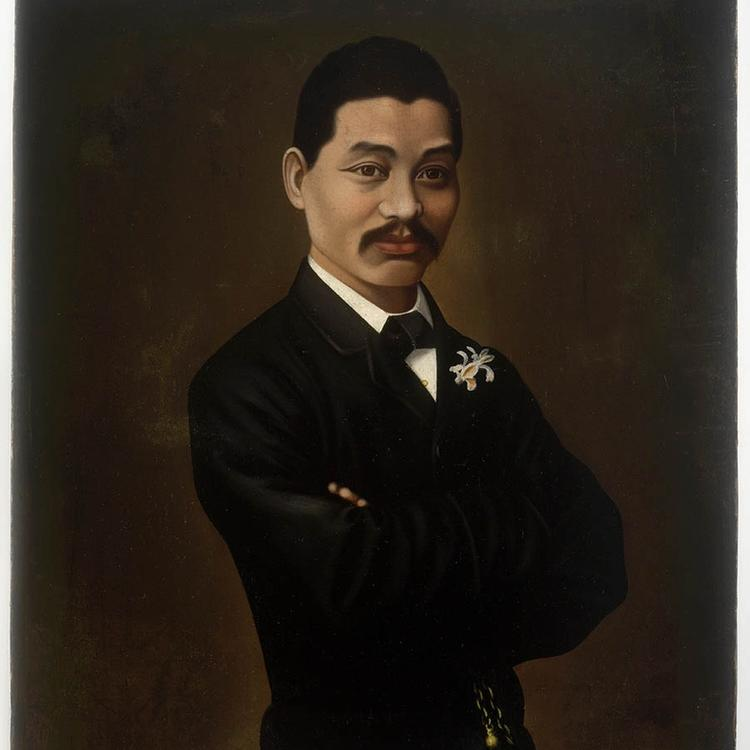 Chinese man in suit with arms crossed