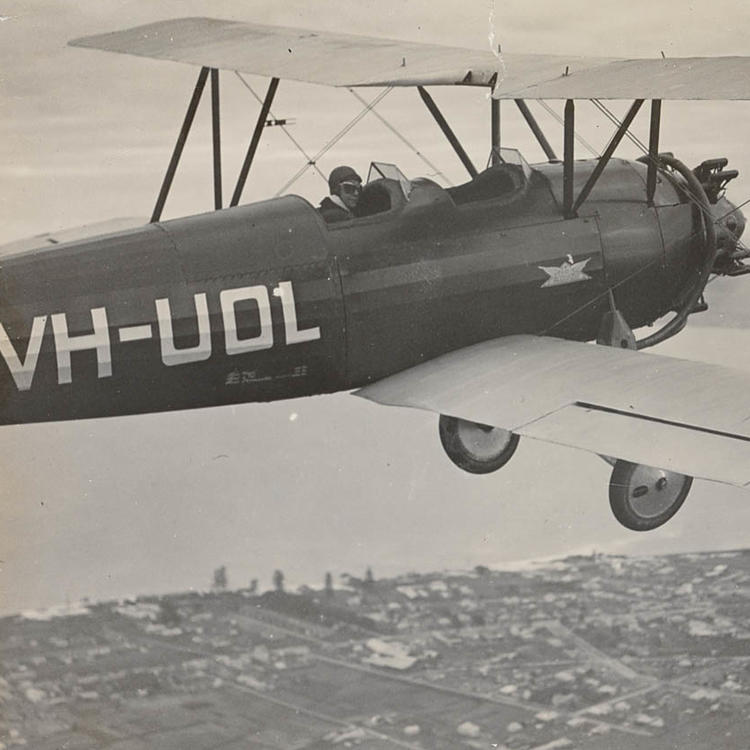 C.T.P. Ulm flying aircraft VH-UOL over Mascot