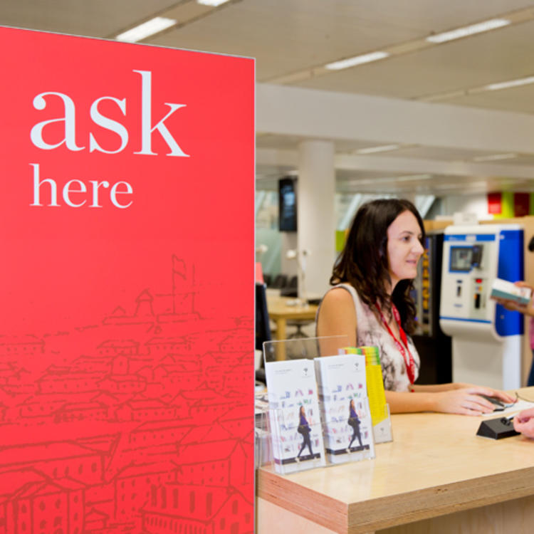 Staff member at the ask here service desk