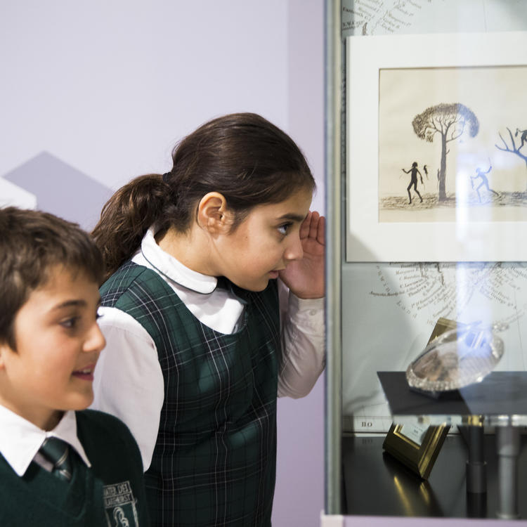 girl and boy looking at display case