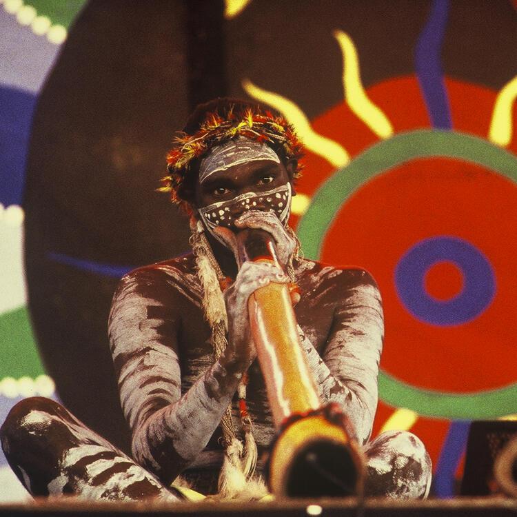 Member of the Yolngu band Yothu Yindi,  Milkayngu Mununggurr, plays Didj. Survival Day concert La Perouse, Sydney. Friday 26th January, 1996