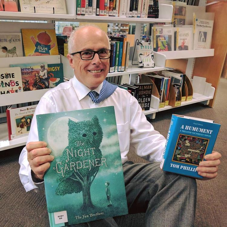 Dr John Vallance with children's books