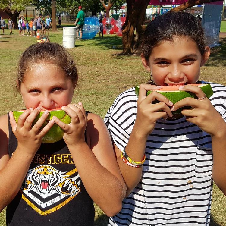 Three girls eating watermelons