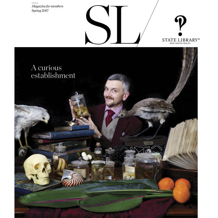 Front cover of SL magazine, spring 2017 issue, featuring man at desk surrounded by collections