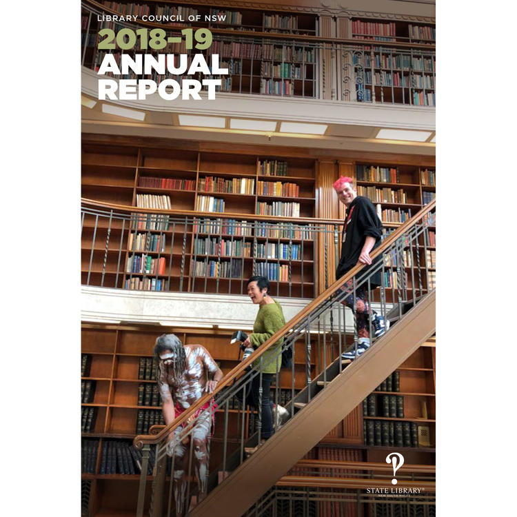 Cover of annual report. An Aboriginal man wearing ochre, a woman with a camera, and a man with pink hair descend stairs surrounded by wall-height bookshelves.