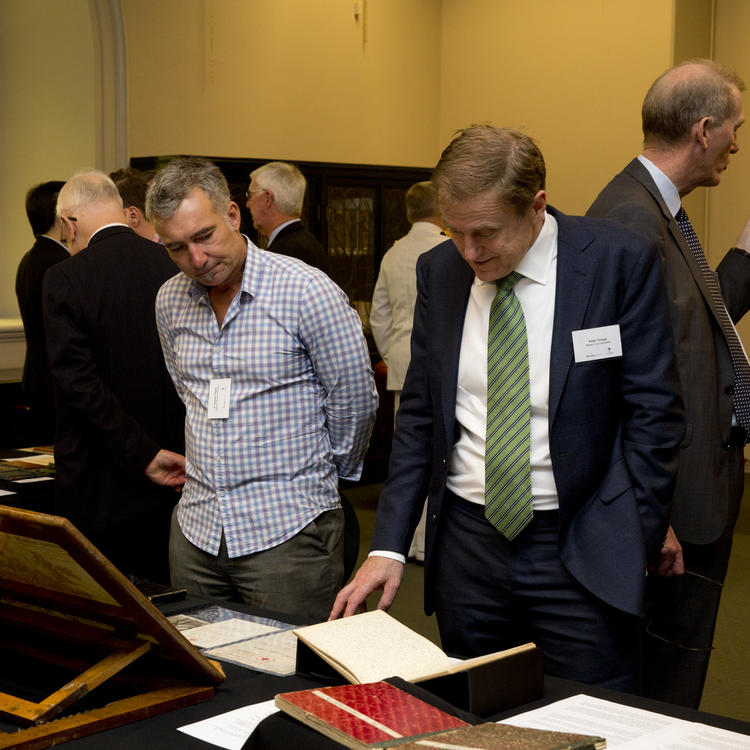 Crowds looking at diaries at large event
