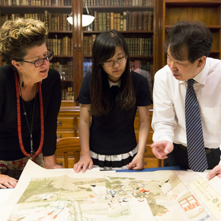woman discussing map with two people