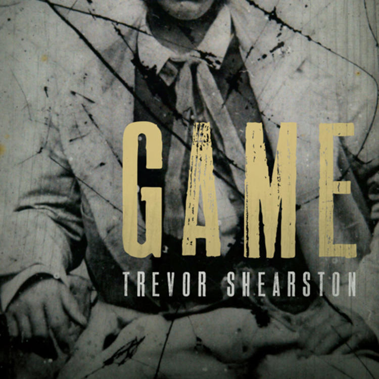 Old photograph of man sitting in a suit on book cover of Game by Trevor Shearston