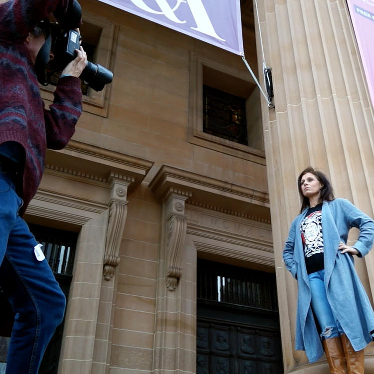 Tony Mott photographs Kasey Chambers on the steps of the State Library.