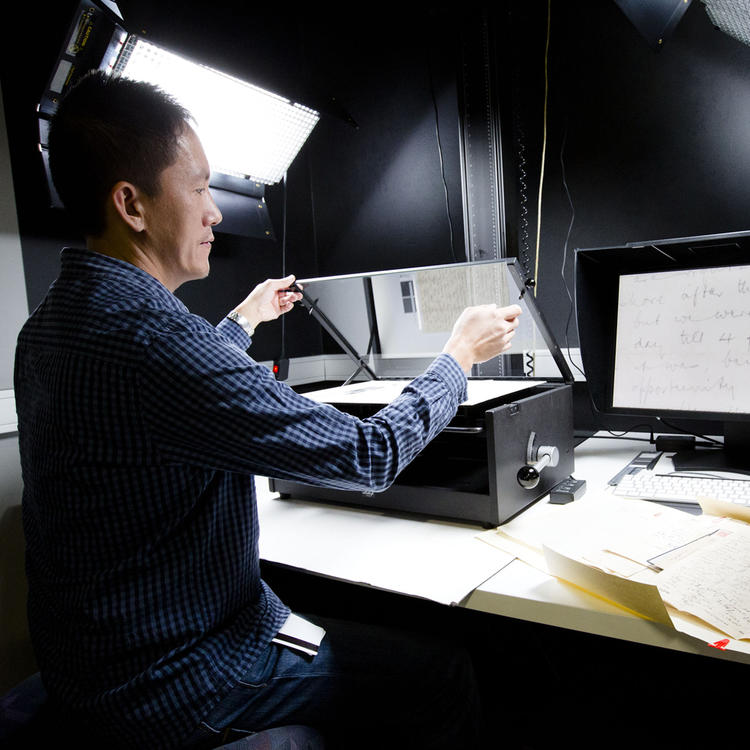 Conservator scanning in several manuscripts