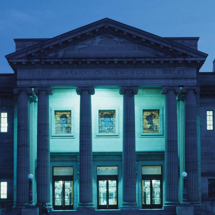 Exterior of large building with blue lights