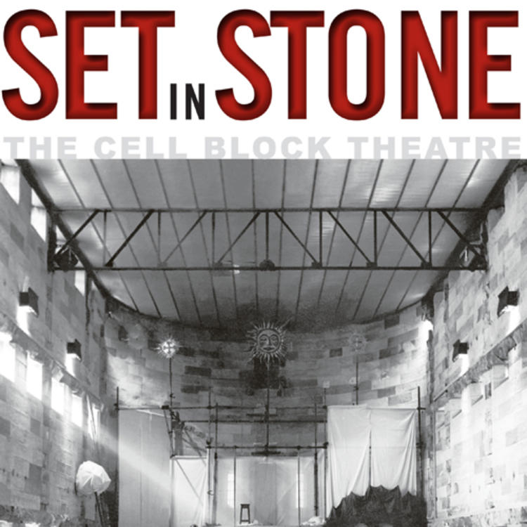 Old theatre with 4 men talking at the stage in front of empty rows of seats on book cover of Set in Stone - The Cell Block Theatre by Deborah Beck