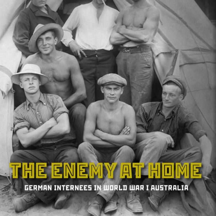 Group of men wearing hats outside a tent in World War 1 on cover of the Enemy at Home - German Internees in World War 1 Australia by Nadine Helmi and Gerhard Fischer