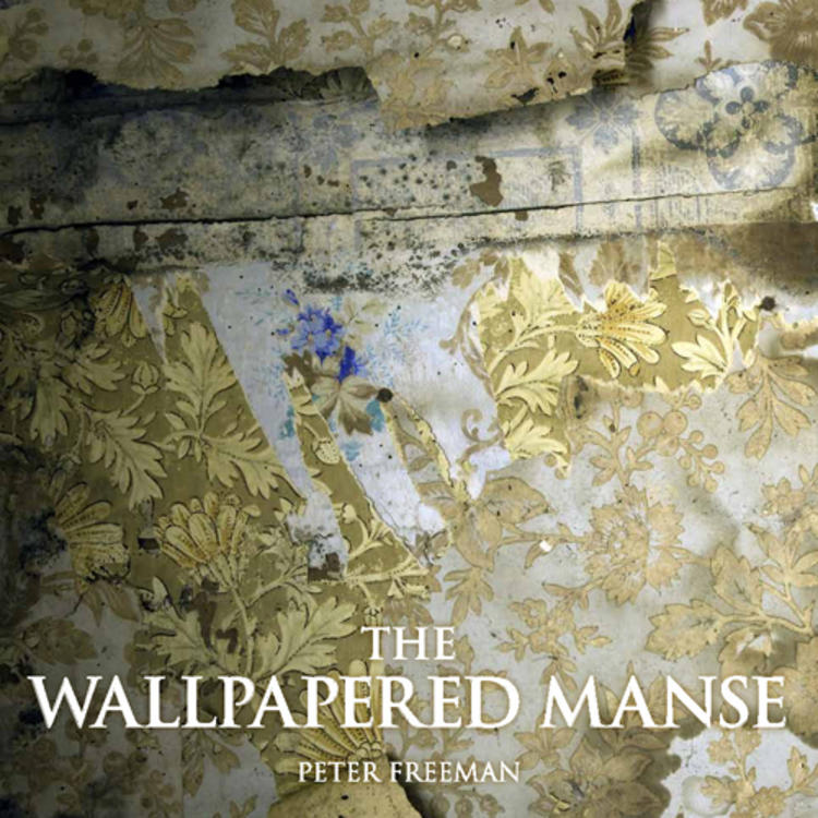 Old wall paper ripped on wall on cover of The Wallpapered Manse by Peter Freeman