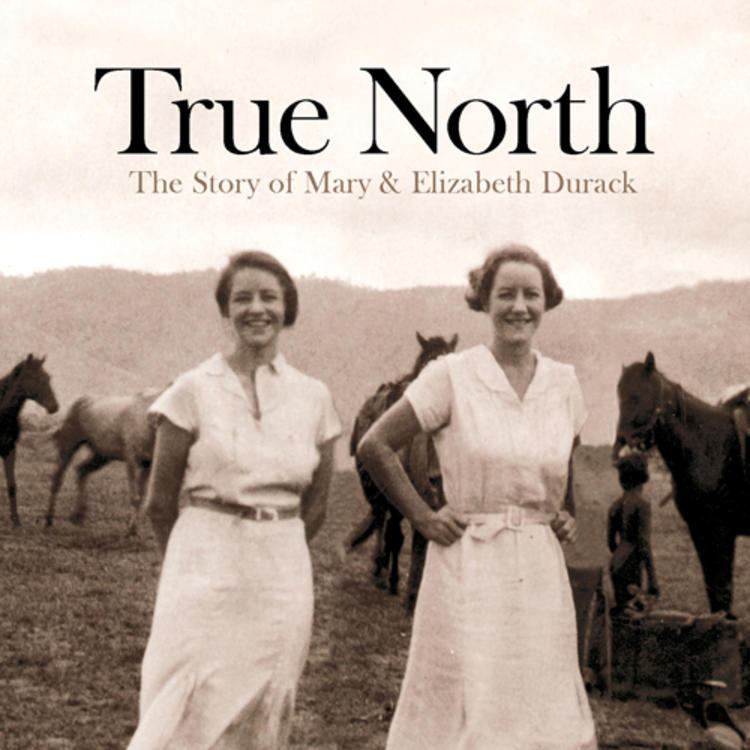 Two women standing in front of a group of horses in a paddock on bookcover of True North The Story of Mary & Elizabeth Durack by Brenda Niall