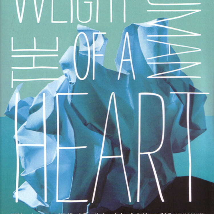 Crumpled paper on a surface for book cover of The Weight of a Human Heart by Ryan O'Neill