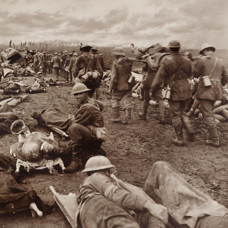 Image of soldiers carrying wounded on stretchers