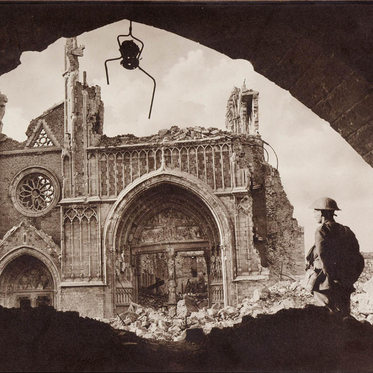 Soldier standing in the rubble of a destroyed church