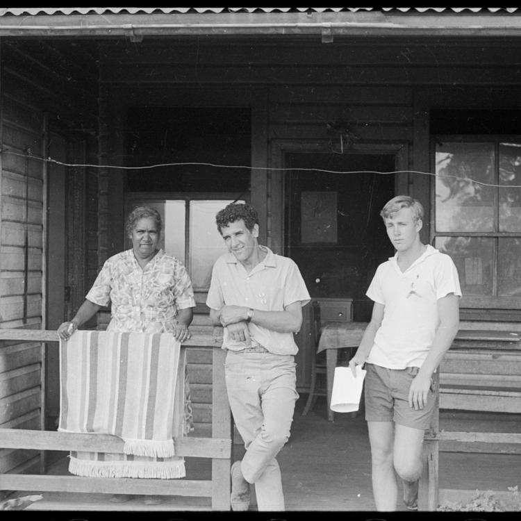 three people on a wood verandah