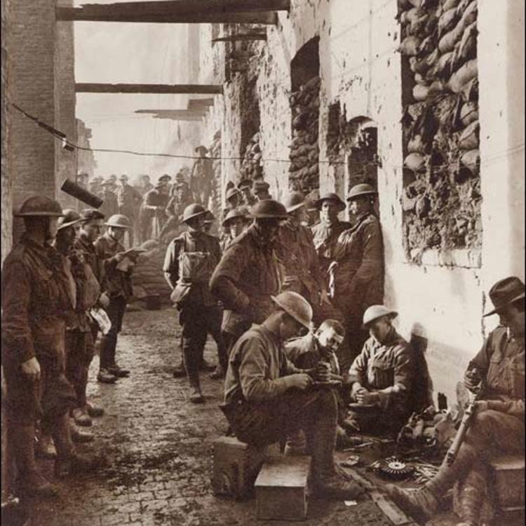 Soliders standing and sitting in an alley