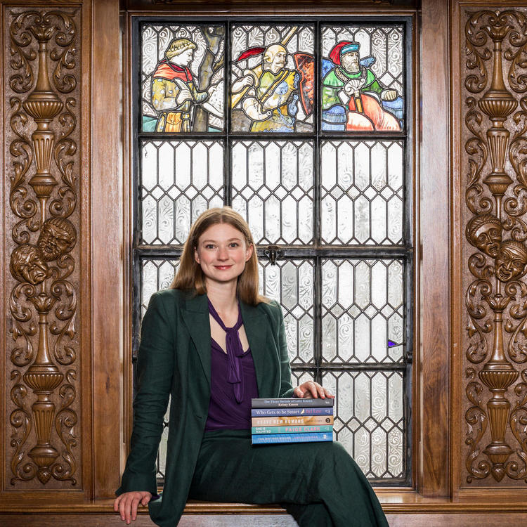 Bri Lee sitting by stained glass window