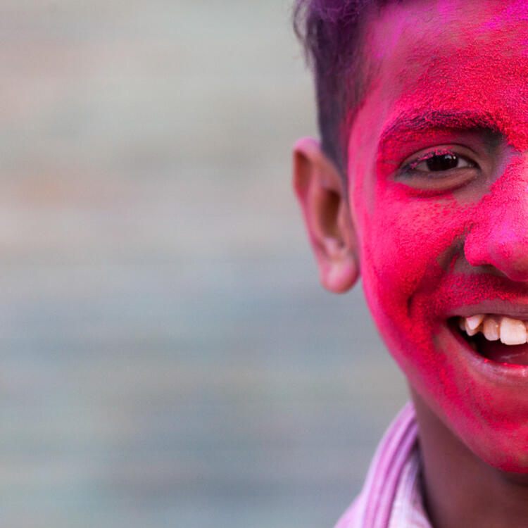 Young boy with pink face paint