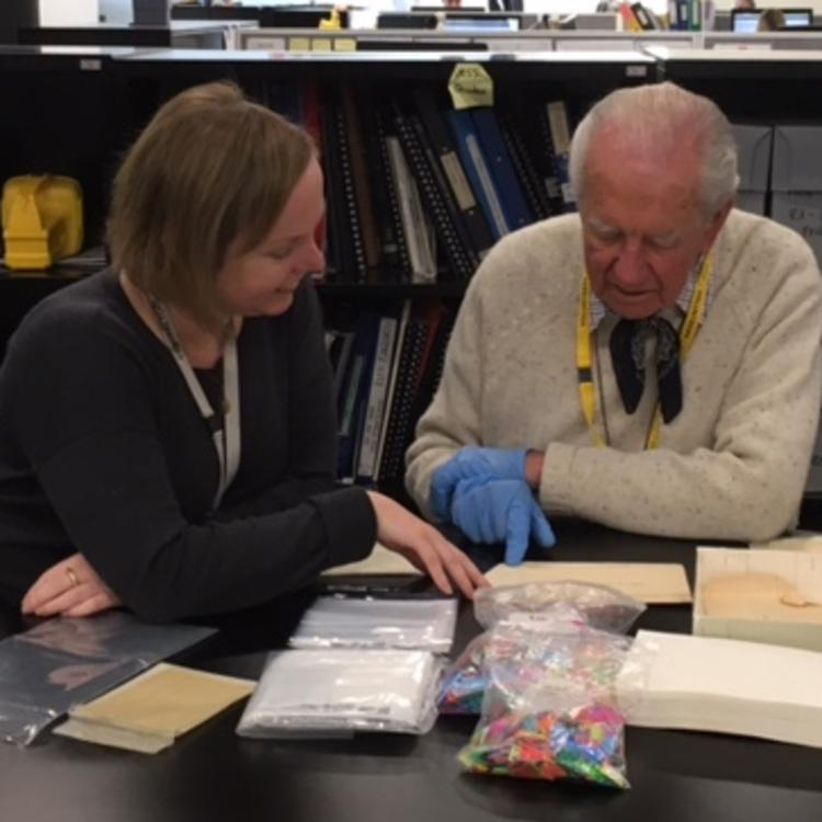 Library volunteer John Ryrie being trained by Project Cataloguer Belinda Hungerford
