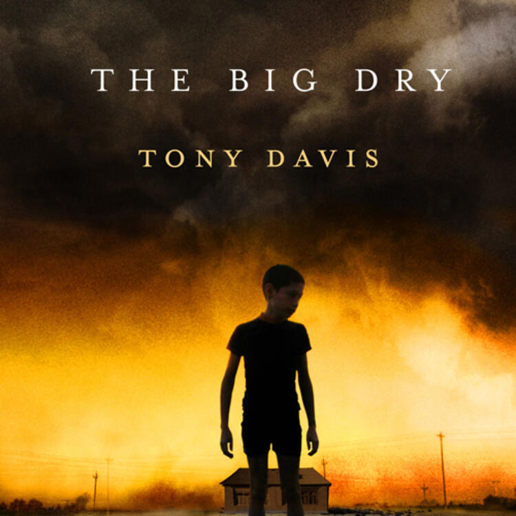Boy standing with a building behind him on cover of The Big Dry by Tony Davis