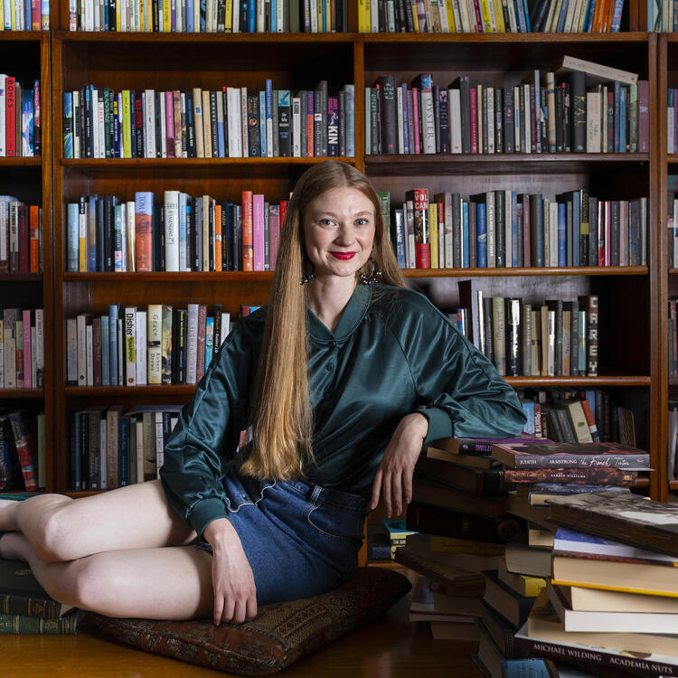 Bri lee on a desk with books