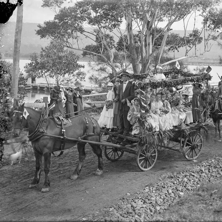 Two horse - drawn floats