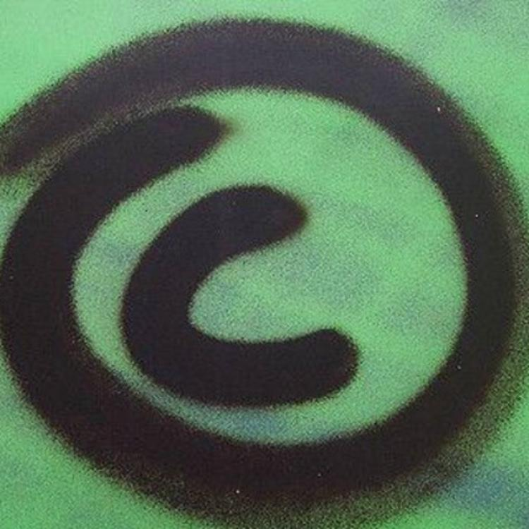 copyright logo in black on green background