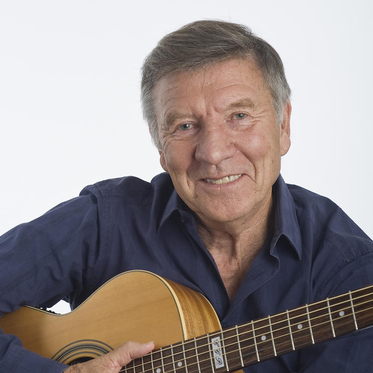 Singer & author Don Spencer, holding a guitar