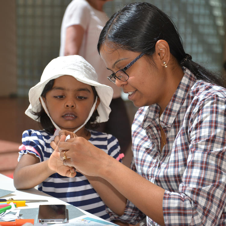 A mother and daughter making crafts