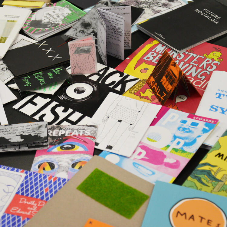 A table full of different kinds of 'zines'