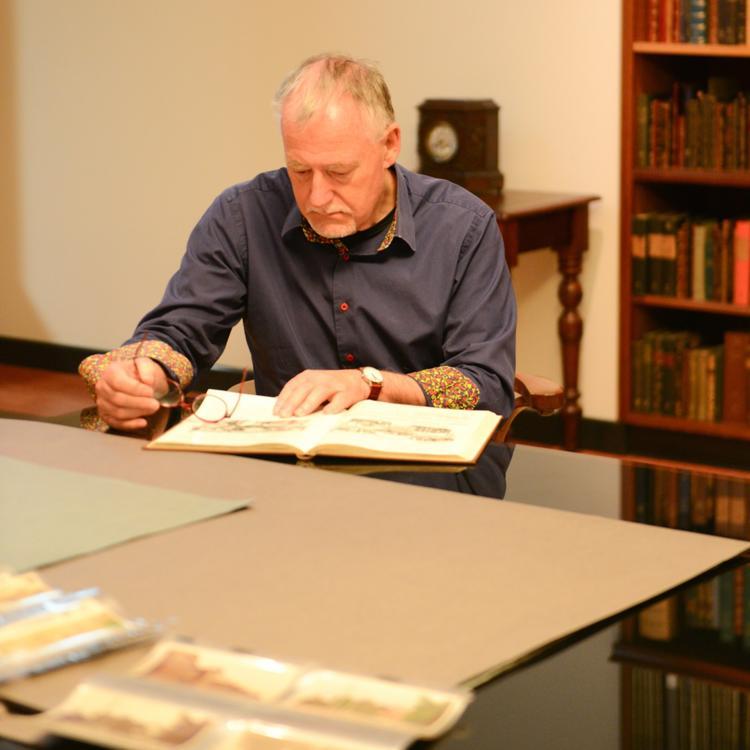 A man looking through a book