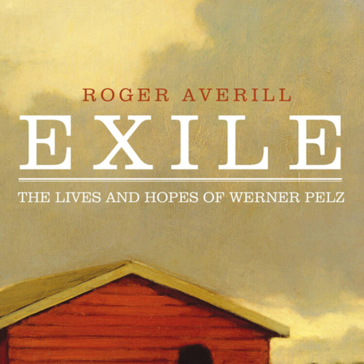 Back of a man standing in front of small wooden building for book cover Exile - The lives and hopes of Werner Pelz by Roger Averill