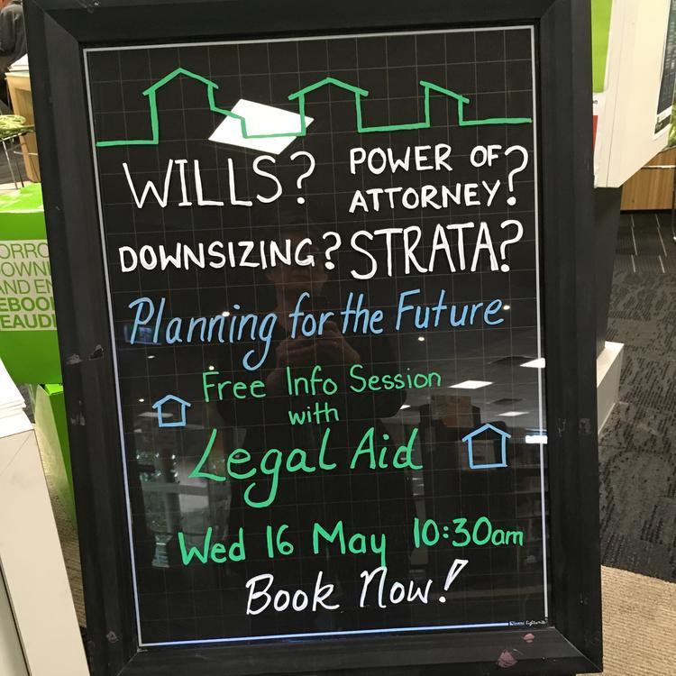 A blackboard advertising a legal talk