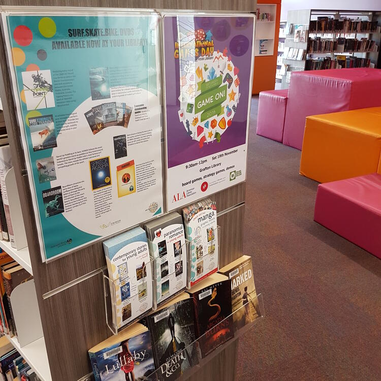 Showing the end of a bookshelf with library promotions