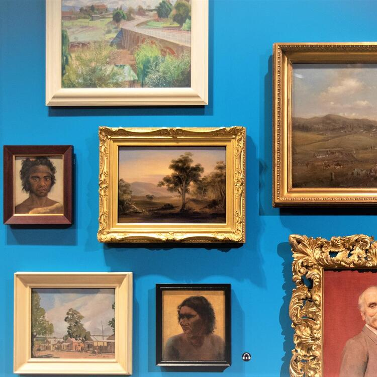 Paintings on blue wall