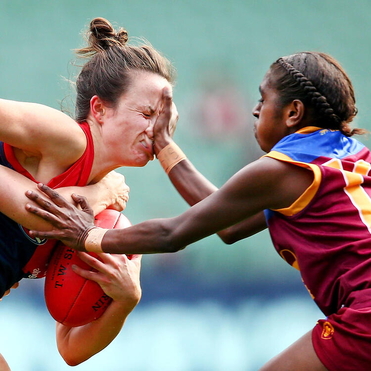 Daisy Pearce. The Melbourne Demons' Daisy Pearce is tackled by Emily Bates and Delma Gisu of the Brisbane Lions in a 2016 AFL Womens match at the Melbourne Cricket Ground on May 22, 2016