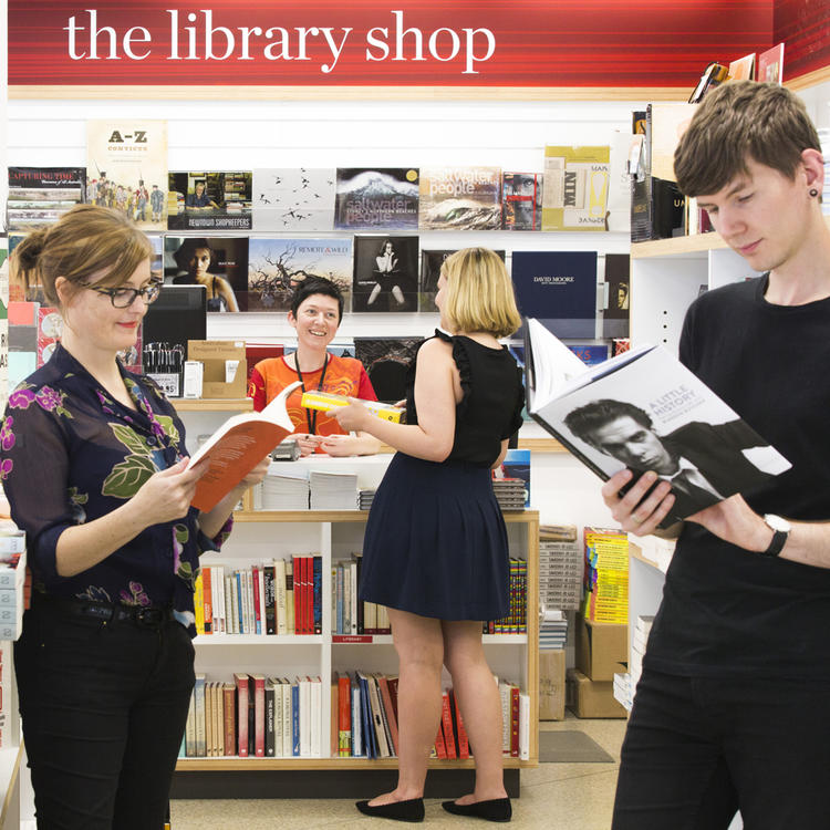 People talking and reading books in bookshop