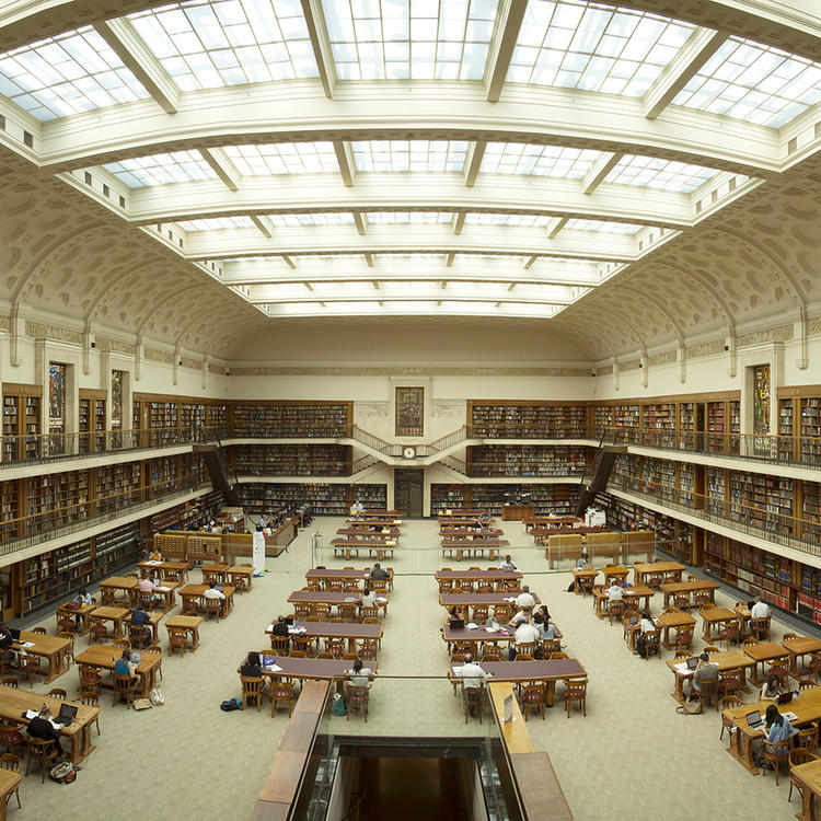 Large spacious room of several levels with desks and bookcases