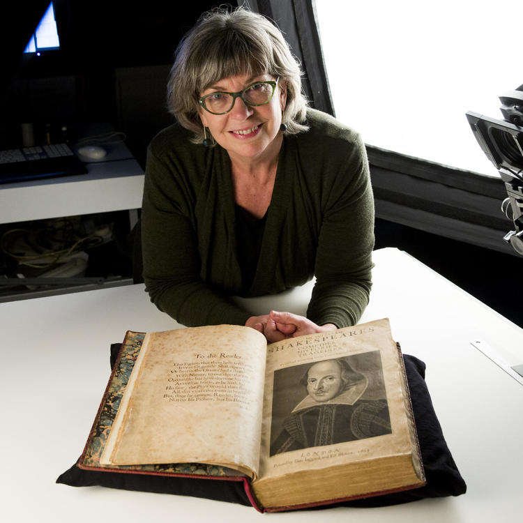 Maggie Patton with Shakespeare's First Folio