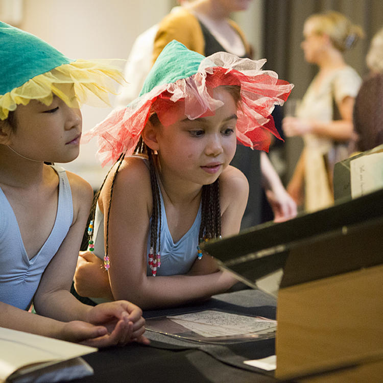 Two girls looking at laptop screen