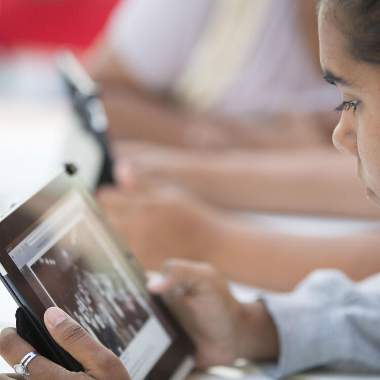 A girl looking at an iPad