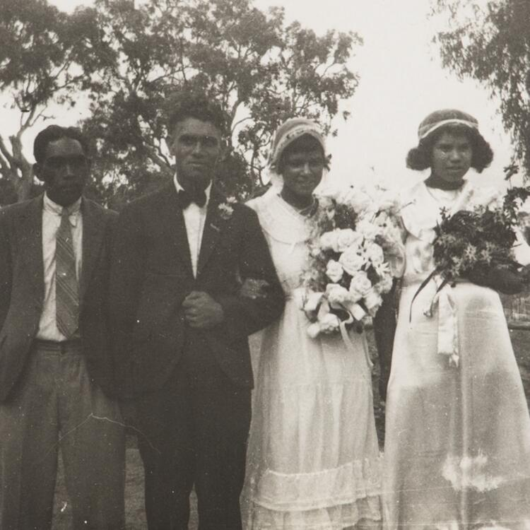 2 men and 2 women wearing wedding clothes